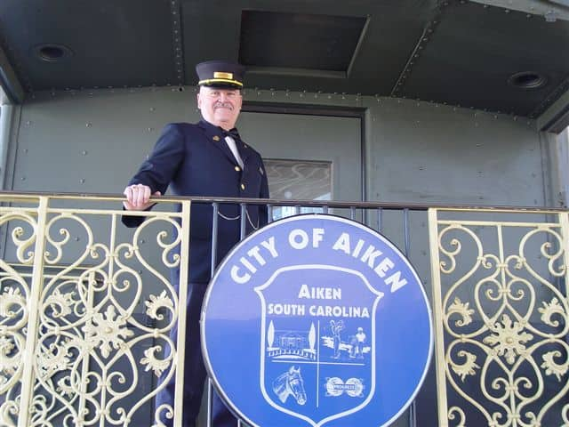 Aiken's historic train depot serves as a welcome center for tourists, complete with genuine passenger cars and a handsome conductor.